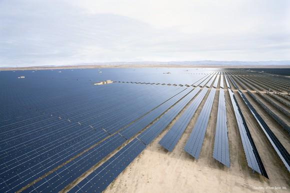 A solar farm in the desert on a sunny day.