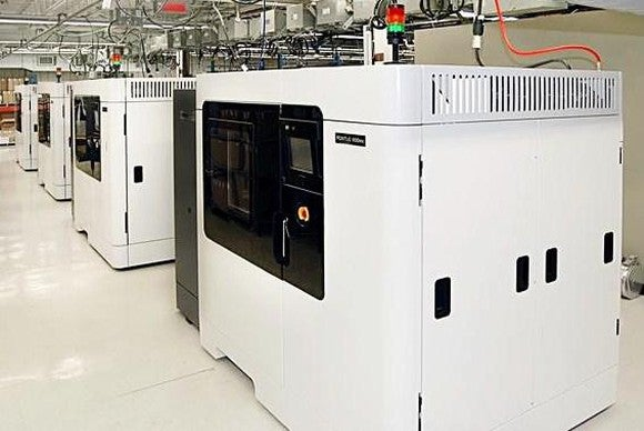A line of Stratasys' Fortus 3D printers.