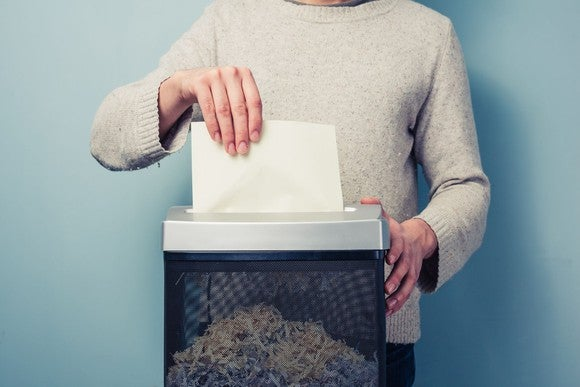 Man shredding documents in a paper shredder