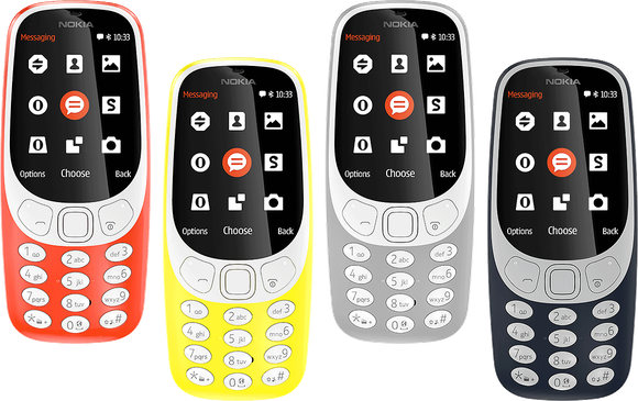 The new Nokia 3310, pictured in each available color: red, yellow, gray, and dark blue.
