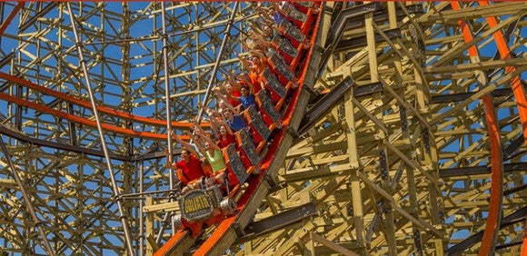 People riding a roller coaster.