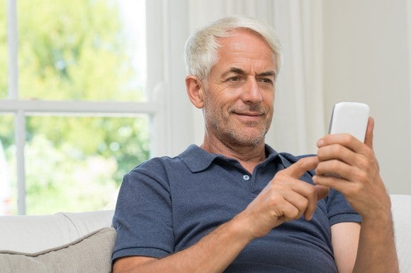 Older man using his phone