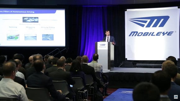 Mobileye executive giving a presentation at a conference.