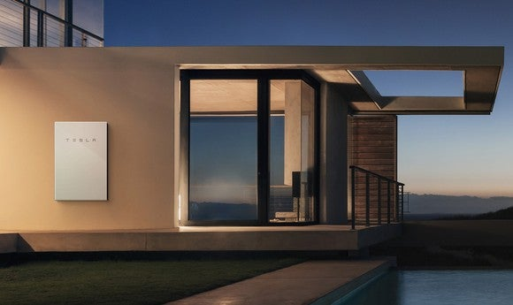 Tesla's Powerwall on a home pictured at night.