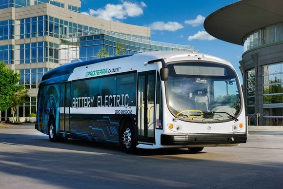 A Proterra electric bus drives down the road.