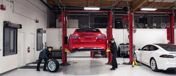 Tesla technicians performing service on a Model S