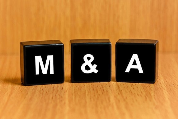 """""""M&A"""" spelled out with black letter blocks."""