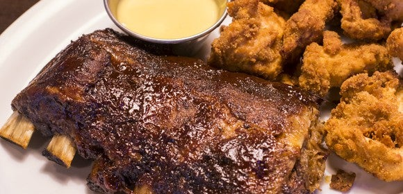 """The """"ultimate"""" catering feast featuring ribs, chicken tenders, and sides at Ruby Tuesday."""