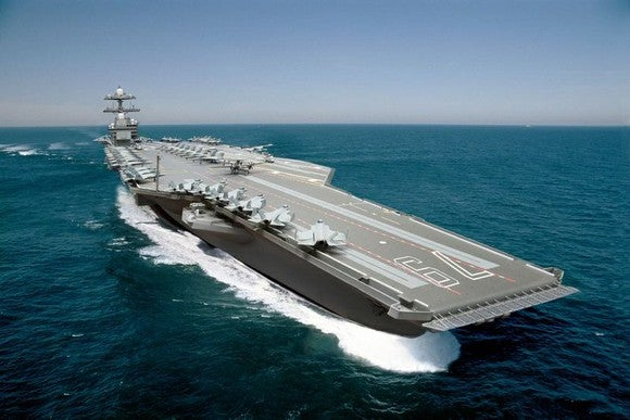 Ford-class supercarrier on open water.