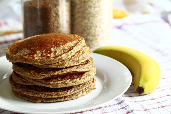 A stack of pancakes and a banana.