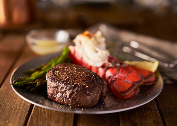 A steak and lobster meal.