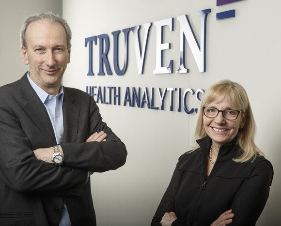 Truven Health Analytics CEO Mike Boswood left and IBM Watson Health General Manager Deborah DiSanzo right