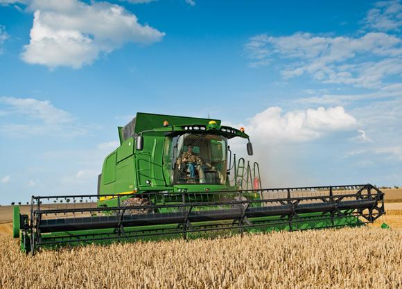 A Deere combine harvester in action