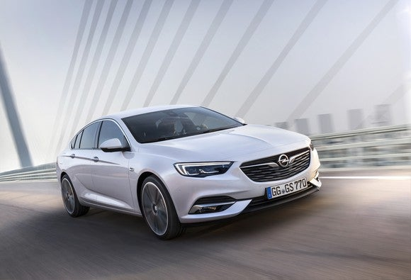 A white 2018 Opel Insignia sedan on the road.