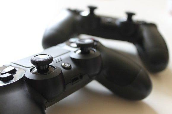 Two video game controllers.