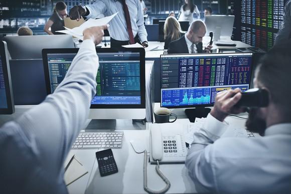 Men at trading desks