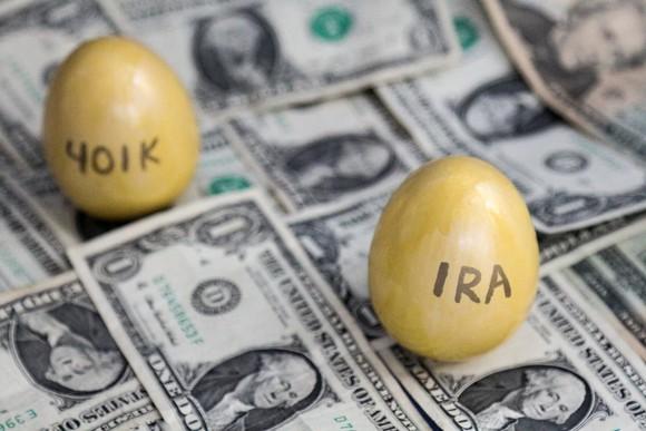 IRA and 401K golden eggs on one dollar bills