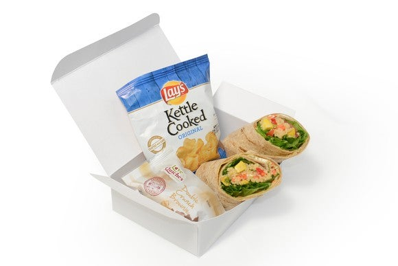 Boxed lunch of airplane food.