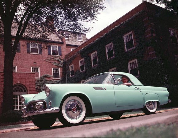 A green 1955 Ford Thunderbird.