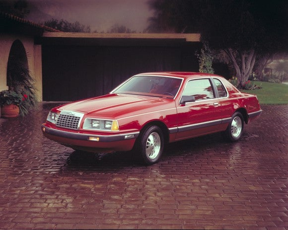 A red 1983 Ford Thunderbird.