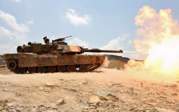 M1 Abrams tank firing cannon.