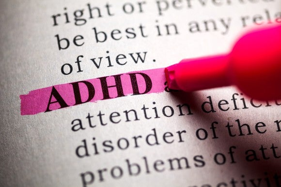 Book text with ADHD highlighted in pink