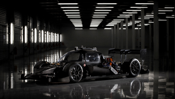 A DevBot pictured in black. The car has a cockpit, unlike the Robocar, allowing an engineer to take control and drive if needed.