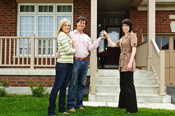 Couple and realtor at a mortgage closing