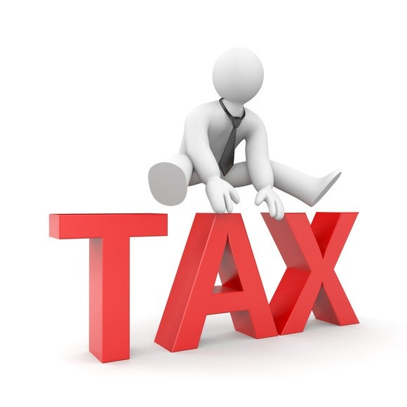 Drawn figure of person leaping over the word tax