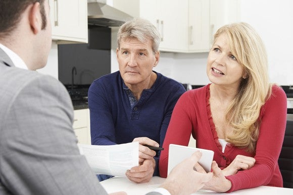 Couple discussing refinancing options
