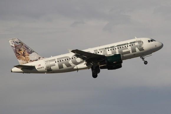 Frontier Airlines plane in flight.
