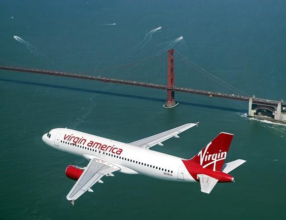Virgin America plane flying near the Golden Gate bridge.