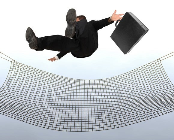A business person falls from the sky into a net.