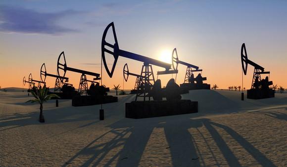Oil pumpjacks operating in the desert.