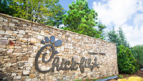 The Chick-fil-A logo on a stone wall