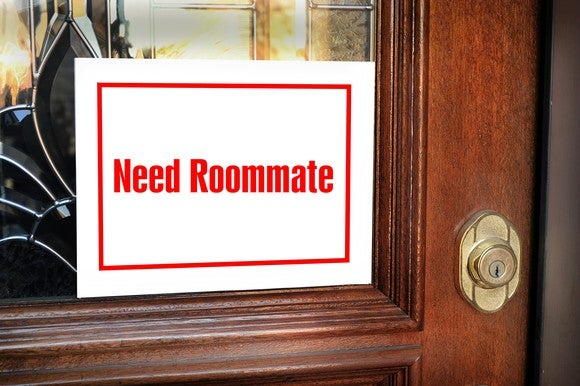 A roommate wanted sign on a door