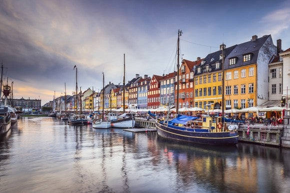 Colorful houses and some boats along the river in Copenhagen, Denmark.