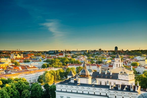 Sun setting over buildings in the old town of Vilnius, Lithuania.