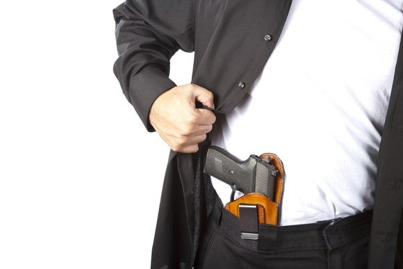 Man with a pistol in his waistband