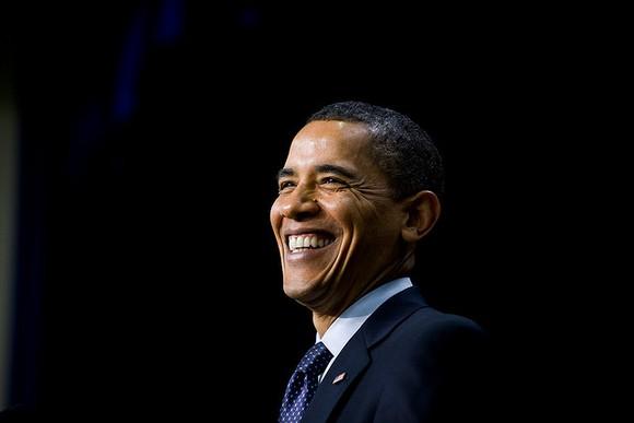 Former President Barack Obama smiling.
