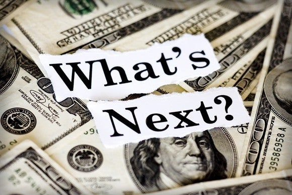 "A pile of cash with the words ""What's next"" written on top, implying no one knows what's next for Obamacare."
