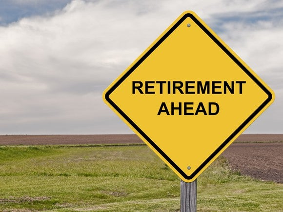 "Yellow diamond shaped street sign saying ""retirement ahead"""