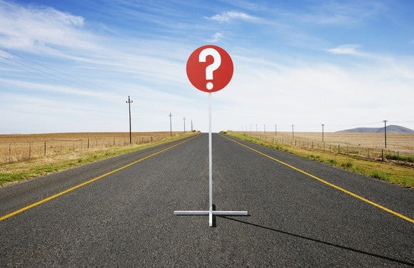 Question sign in the middle of a road