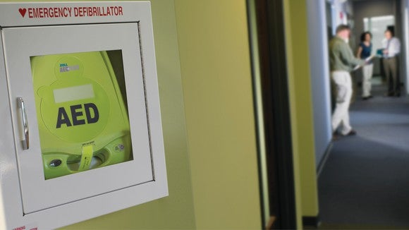 AED device installed in a wall.