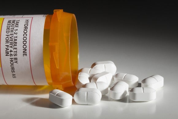 Hydrocodone bottle and pills