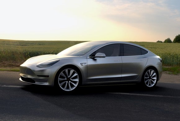 A silver pre-production Tesla Model 3 sedan.