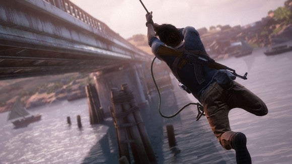 """Nathan Drake from Sony's """"Uncharted"""" series swinging from a rope alongside a bridge."""