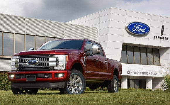 A red Ford Super Duty pickup in front of Ford's Kansas City Assembly plant