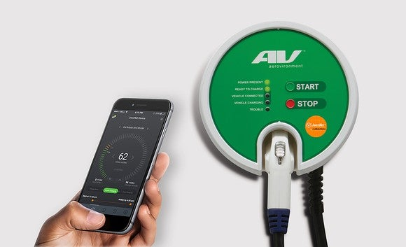 Aerovironment charger next to smartphone showing the app that controls charging.