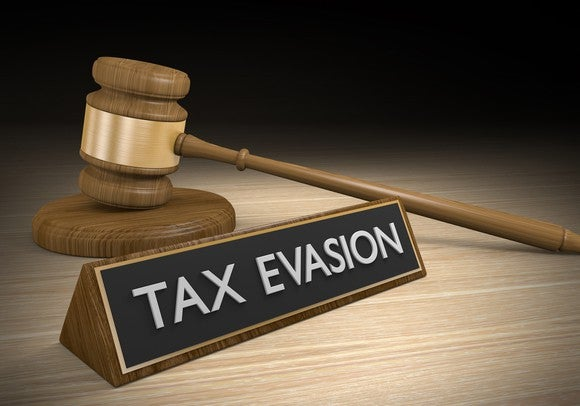 Tax evasion sign with gavel